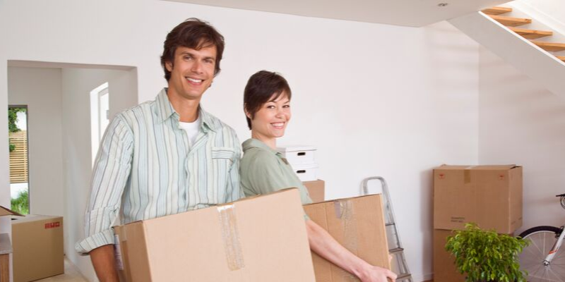 Couple Moving Holding Boxes