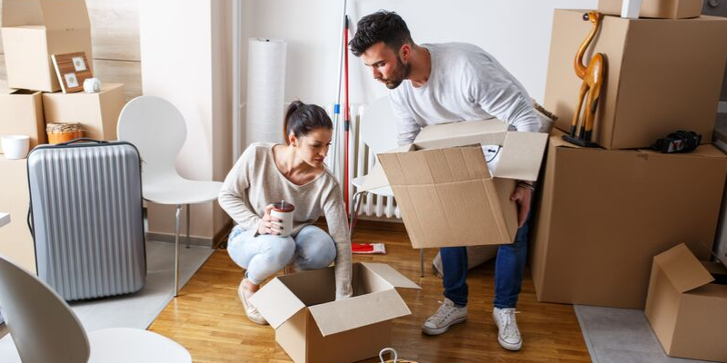 Couple Packing For A Move